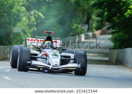 AARHUS, DENMARK - MAY 17 2014: Johan Rajamaki in a BAR/HONDA formula one racing car at the Classic Race Aarhus 2014 - stock photo