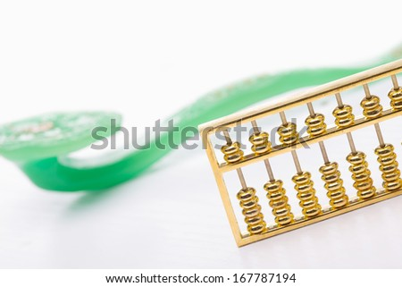 abacus and jade ruyi with background - stock photo