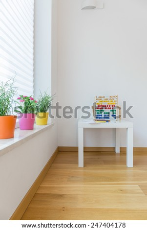 Abacus on a table in child room - stock photo