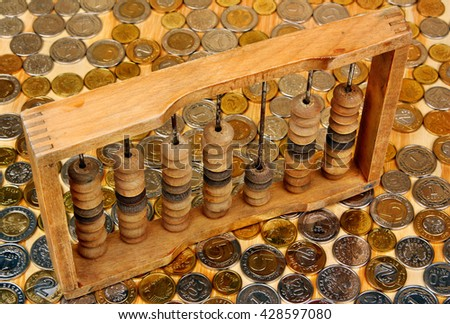 Abacus on the polish money coins background - stock photo