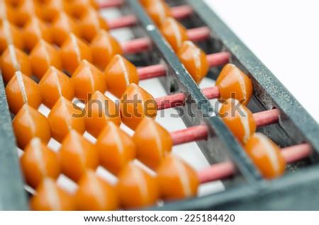 abacus on white background-close up - stock photo