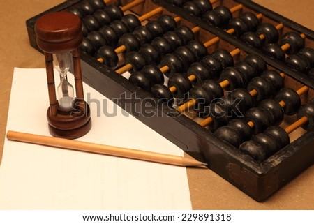 abacus with note - stock photo