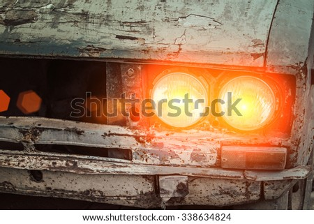 Abandon car with lighting lamp - stock photo