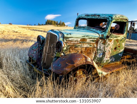Abandon for years and old trucks rusts on a farm