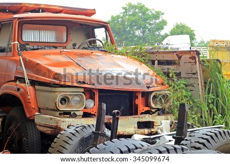 Abandon for years and old trucks rusts on a farm - Old abandoned truck - stock photo