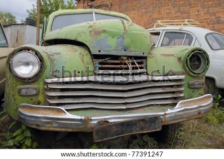 Abandoned an old broken car - stock photo