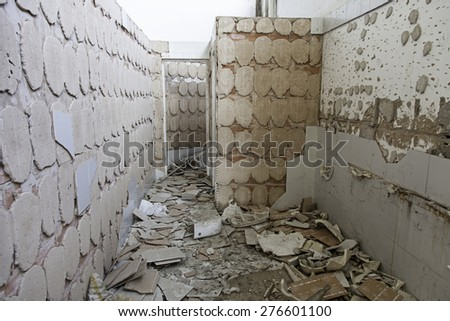 Abandoned and derelict building, detail of a solitary building - stock photo