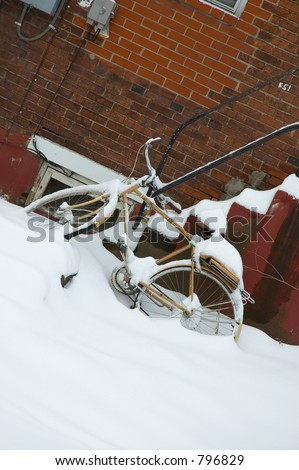 Abandoned bike covered in snow.