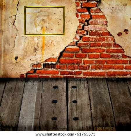 Abandoned brick wall, wood floor and gold frame - stock photo