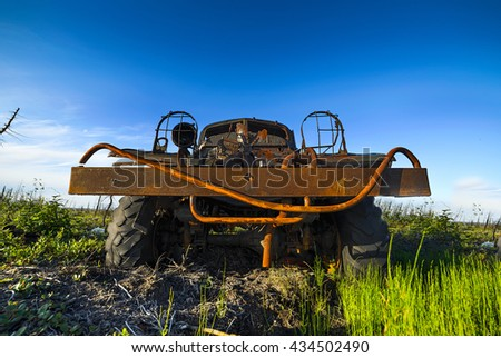 Abandoned, broken, rusting military truck in the tundra. Evening light, low sun, blue sky. - stock photo
