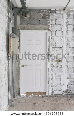abandoned building and white door old