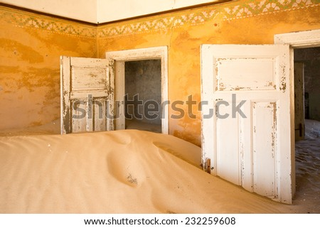 Abandoned building being taken over by encroaching sand, Kolmanskop ghost town, Namib Desert