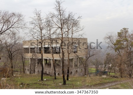 abandoned building houses standing on the hill among trees