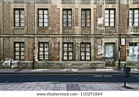 Abandoned building in an impoverished area. - stock photo