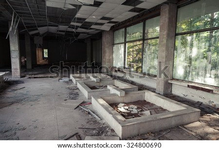 Abandoned building interior. Corridor perspective with broken ceiling and windows. Vintage tonal photo filter effect, old style - stock photo