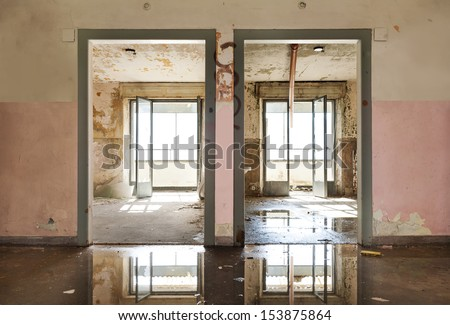 abandoned building, view room from the corridor, two doors - stock photo