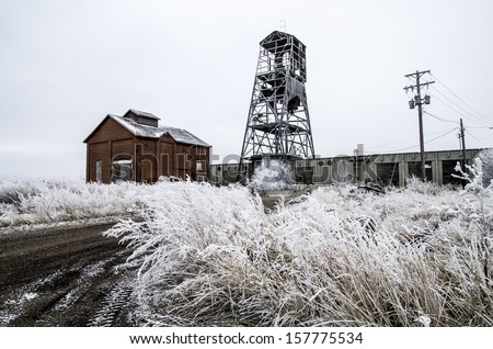 Abandoned Buildings. Works at historic coal mine in Lethbridge, Alberta. Hoar frost on prairie vegetation.  - stock photo