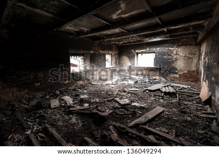 Abandoned burned out building - stock photo