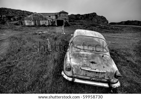 Abandoned car and farm in black and white, end of the word concept. Location, Iceland. - stock photo