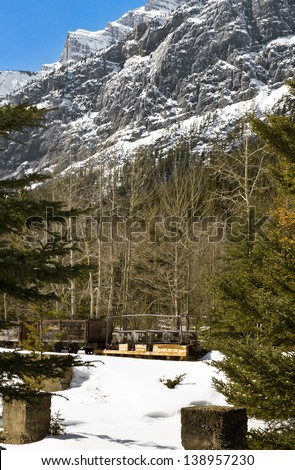 Abandoned coal rail cars at Bankhead, a ghost town at the base of Cascade Mountain, Banff National Park, Canada. - stock photo