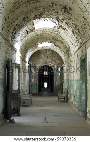 abandoned corridor in old prison - stock photo