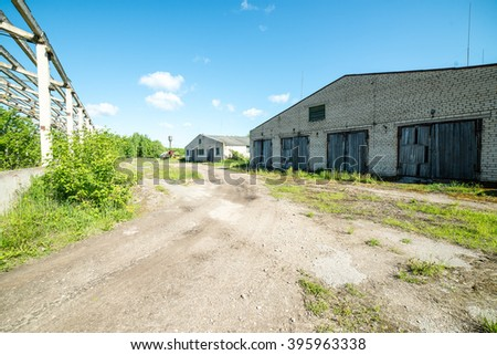 abandoned country farm building in bright summer sun in latvia - stock photo