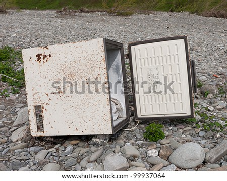 Abandoned dangerous old freezer - environmental damage, rubbish disposal concept