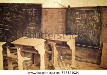 abandoned desks in a old school