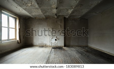 Abandoned empty room with light coming in through a window