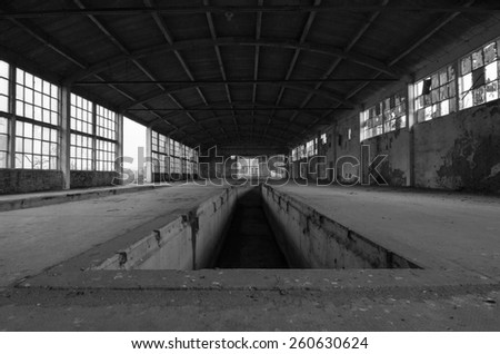 Abandoned factory building in black and white.