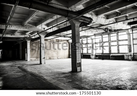 Abandoned factory hall - stock photo
