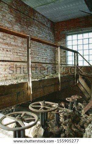 Abandoned factory. Rusty valves and pipes. An industrial grunge scenery