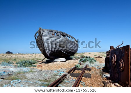 abandoned fishing trawler on beach. old ship wreck on english south coast in dungeness - stock photo