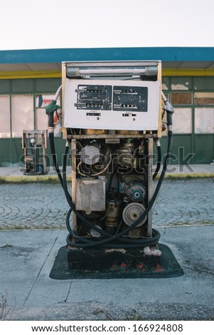 Abandoned gas pump at the station - stock photo