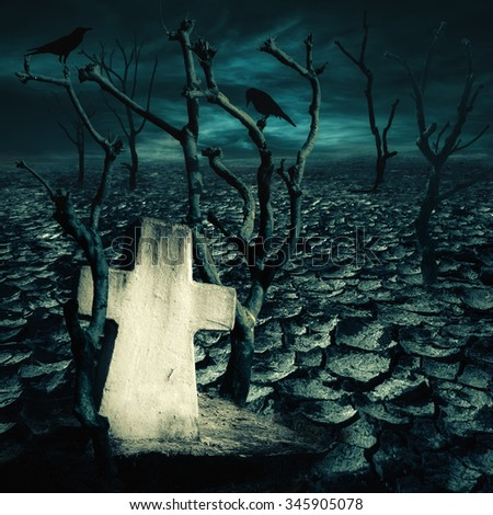 Abandoned grave at haunted mysterious desert with black ravens seating on dead trees under dramatic night sky. Dark spooky landscape for evil and death concept - stock photo