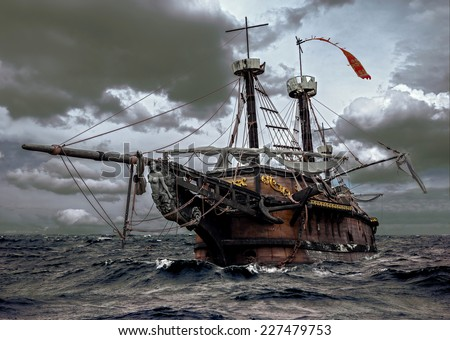 Abandoned historic sailing ship in the stormy sea. Wooden sailboat sails in a storm at ocean. A mysterious boat in stormy waves.