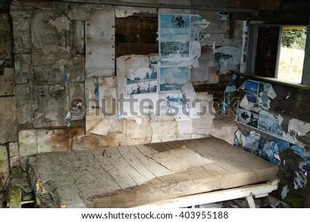 Abandoned historical hut interior - stock photo