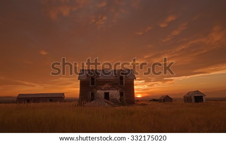 Abandoned homestead at sunset, Montana.