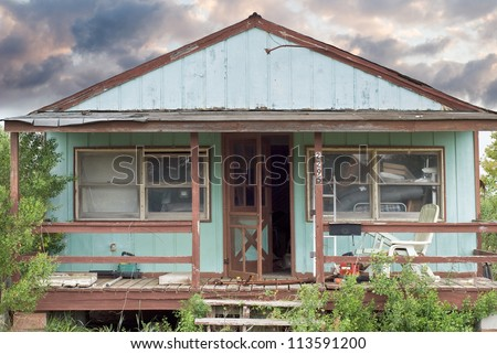 Abandoned House as Sign of Economic Recession - stock photo