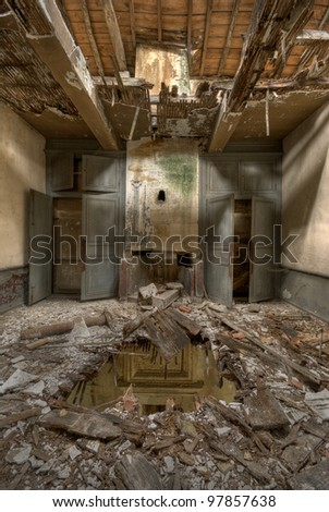 Abandoned house destroyed by disaster - stock photo