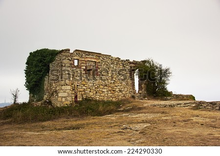 Abandoned house in the hill at sunset (La Mussara, Tarragona, Spain) - stock photo