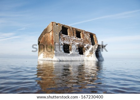 Abandoned house in water, cold winter with icicles - stock photo