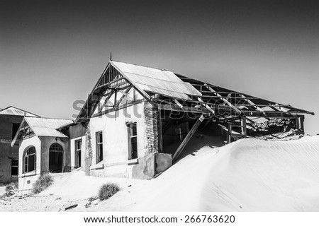Abandoned house of   Kolmanskop. It was settled by German in 1908 with a purpose of diamond searching - stock photo