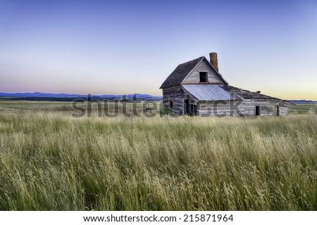 Abandoned house on South Dakota Landscape. - stock photo