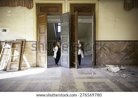 Abandoned house with girls crazy and paranoid - stock photo