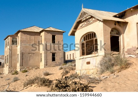 Abandoned houses in sand.  - stock photo