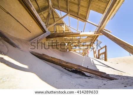 Abandoned houses in the ghost town of Kolmanskop, near Luderitz, Namibia