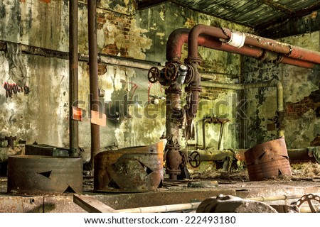 Abandoned Industrial building interior. Old damaged boiler room. - stock photo