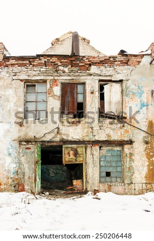 Abandoned industrial building. The ruins of the Soviet Union. - stock photo