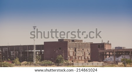 Abandoned industrial buildings -colorized photo - stock photo